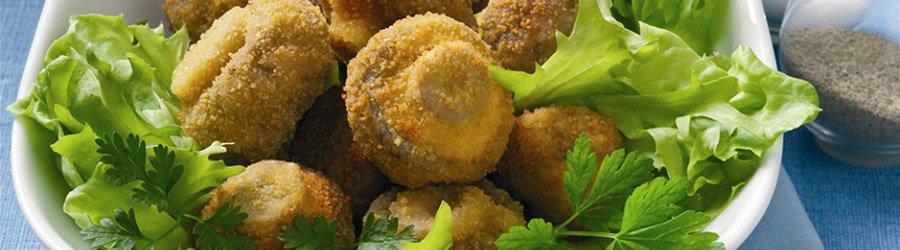 Kräuterchampignons auf Salat
